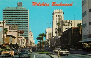 """Wilshire Boulevard"" Postcard (front). circa 1960. Looking east along Wilshire Boulevard; Mullen Bluett and the Wilshire Tower on the right; Bank of America and the Lee Tower on the left."