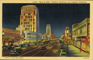 """Miracle Mile"" at night; linen finish postcard (front), circa 1940. Dominguez-Wilshire building on right."