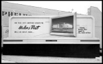 Billboard promoting the construction of the Muellen and Bluett store on Wilshire Boulevard, circa 1948. The billboard depicts an early design for the store, one that was revised by the time of construction in 1949.