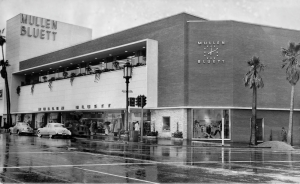 Mullen and Bluett store, circa 1950. Stiles O. Clements designed the two-story, 55,000-square-foot Mullen and Bluett Store. It opened for business in 1949 and was demolished in 2006. Mullen and Bluett was a very successful clothing store – one of many along the Miracle Mile in its prime as a retail center.