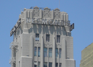 Contemporary view of the neon signs on the Desmond's tower. The Desmond's signs are featured on the north and south sides of the tower; the Silverwood's signs are on the east and west sides. These are the only historic neon signs still in existence in the Miracle Mile.