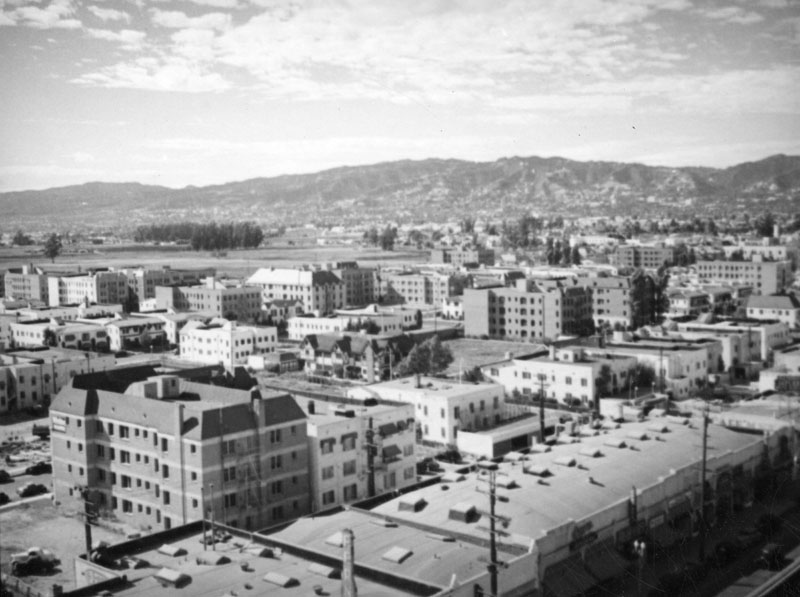 View to the northwest from the E. Clem Wilson Building at La Brea Avenue and Wilshire Boulevard, circa 1930. The commercial buildings in the foreground are ...