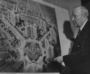 Frederick H. Ecker, chairman of the board of Metropolitian Life Insurance Co., points to a drawing showing a section of the $40,000,000 development the company plans for the Park La Brea residential community. The development will include 18 apartment buildings 13 stories high, business and park areas. Photo dated: March 3, 1948. (Herald-Examiner Colletction; Los Angeles Public Library)