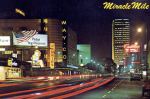 Miracle Mile postcard, circa 1960s; looking east along Wilshire Boulevard at the intersection of Fairfax Avenue.