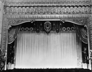 Fox Ritz Theatre proscenium, 1937. View of the elaborate proscenium and stage curtain. (Security Pacific National Bank Collection; Los Angeles Public Library)
