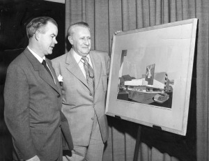 Lawrence L. Frank (right), president of Van de Kamp's, and Architect Welton Becket look over painitng of new Van de Kamp's coffee shop now under construction on the Miracle Mile. It is scheduled to open next month. Photo dated: February 15, 1951. (Herald-Examiner Collection; Los Angeles Public Library)