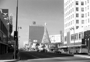 Looking west along Wilshire at La Brea during the Christmas holiday, circa 1960. The Fox Ritz Theatre (left) is for rent; E. Clem Wilson Building (right); and in the distance, behind the Christmas tree, is the Lee Tower, which was constructed in 1959.