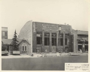 Security First National Bank,  5207-5209 Wilshire Boulevard, nearing the completion of construction, 1929. (California State Library.)