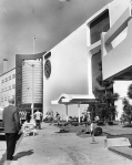 The Seibu department store was constructed in the early 1960s across from the May Company at Wilshire and Fairfax. This view is looking north along Fairfax with the May Company in the distance. The building later housed Orbach's department store and is now the home of the Petersen Automotive Museum. Photograph circa 1962.