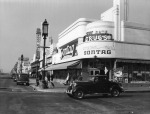 View looking west at the intersection of Wilshire Boulevard and Cloverdale Avenue, circa 1939.. The Sontag Drug Store is seen on the northwest corner. Today it is the location of Wilshire Beauty Supply. The sign for the A and P Food Palace can be seen, the grocery store was next-door to Sontag's.