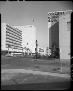 Street scene at Wilshire Boulevard and Curson Avenue, 1949, with Prudential Square at left and Citizen's National Bank buiding at right. (Bartlett Papers; UCLA Digital Collections)