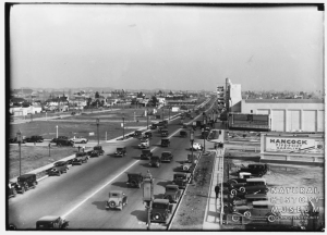 "View looking east along Wilshire Boulevard at he 4 Star Theatre, circa 1933. The theater is showing ""The Match King"" (1932) and ""He Learned About Women"" (1933). [Seaver Center Collection; Los Angeles Museum of Natural History]"