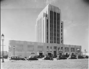 The Dominguez Wilshire Building shortly after opening; photograph dated 1931. Signs on the street level facade identify the leasing agent as A. W. Ross (the creator of the Miracle Mile). The signs also tout that the building is 75% rented. (Los Angeles Examiner Collection, 1920-1961; USC Digital Library)