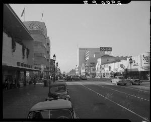 View of Wilshire Boulevard, circa 1952, looking west at Mullen-Bluett, Coulter's Deparment Store, and Ralphs Market (on right).