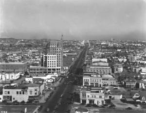 View of Wilshire Boulevard looking east, circa 1930. The E. Clem Wilson Building at the northeast corner of Wilshire and La Brea is under construction.
