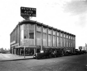 View of the northwest corner of Wilshire and Hauser showing the Western Auto Supply Co. Building. Several cars are seen parked on Hauser Blvd.; circa 1930s. (Water and Power Associates)