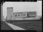 A billboard on the south side of Wilshire Boulevard (just west of Stanley Avenue) promoting the war effort in 1943. {Library of Congress)