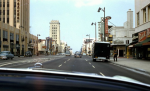 Windshield view west along Wilshire Boulevard, circa 1955.