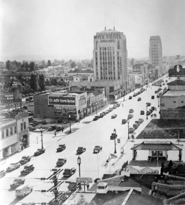 Wilshire Boulevard., circa 1932. View from the E. Clem Wilson Building at Wilshire and La Brea, looking west along Wilshire Boulevard, circa 1932. Myer Siegel Department Store occupied the two-floors at the base of the Dominguez Building at 5400 Wilshire. In the distance is the Wilshire Tower, also known as the Desmond's building – so named for Desmond's, the first department store to locate in the Miracle Mile.