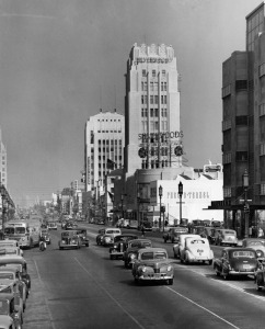 Looking east down Wilshire Boulevard at Burnside Avenue, circa 1949. Coulter's Department Store in on the right. Phelps Terkel was a men's clothiers. Silverwood's, another men's clothier, shared the two-story base of the Wilshire Tower with Desmond's Department Store. The Dominguez Building is in the distance.