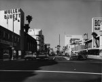 Wilshire Boulevard, circa 1955. Mullen and Bluett, on left, at 5570 Wilshire Boulevard was a high-end clothing store specializing in menswear. Stiles O. Clements designed the two-story, 55,000-square-foot store in 1947-1948. It was demolished in 2006.