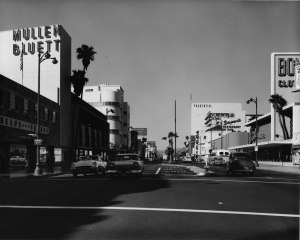 Wilshire Boulevard, circa 1955. Mullen and Bluett, on left, at 5570 Wilshire Boulevard was a high-end clothing store. Stiles O. Clements designed the two-story, 55,000-square-foot store in 1947-1948. It was demolished in 2006.