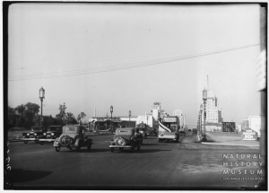 Wilshire Boulevard looking west towards La Brea Avenue, circa 1932. E. Clem Wilson Building (right) and sign for Fox Ritz Theatre (left) can be seen.  [Seaver Center Collection; Los Angeles Museum of Natural History]
