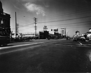 "Wilshire Boulevard facing west towards La Brea Avenue, circa 1930. Wilshire Boulevard and Sycamore Avenue facing west towards La Brea Avenue: Bank of America, McDonnell's Wilshire Cafe, Myer Siegel, Kress, Best Drugs (clock reads 10:04 am), New York Stores, Stenglers, Eastern's Wilshire Store. The Bank of Italy  - as the Bank of America was originally known - purchased the southwest corner of Wilshire and La Brea in 1925 and built a commercial building housing a branch of the bank and retail stores. (""Dick"" Whittington Photography Collection, 1924-1987; USC Digital Library)"