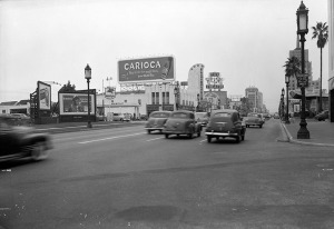 Wilshire Boulevard at Citrus Avenue, 1950. Looking southwest across Wilshire Boulevard from Citrus Avenue, showing billboards and various businesses, including a Mobil service station, the 4 Star Theatre, located at 5112 Wilshire, a Signal Oil service station, a Myer Siegel department store in the Dominguez-Wilshire Building, and the General of American Insurance offices in the E. Clem Wilson Building. Photograph dated May 22, 1950. (Blackstock Negative Collection; Los Angeles Public Library)