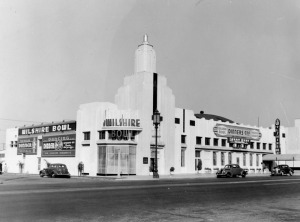 The Wilshire Bowl, located at 5665 Wilshire Boulevard, was the first of several popular night clubs at this location. According to the signage: dinners are advertised at $1.50, there is dancing on Sundays with no cover charge, and Larry Kent and his orchestra play nightly. (Los Angeles Public Library)