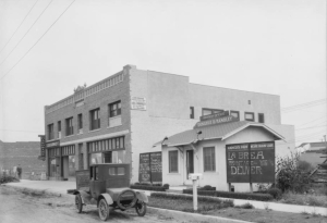 "Donahue-Handley Real Estate office, 322 South La Brea Avenue, 1925. Note that La Brea Avenue is a dirt road. (""Dick"" Whittington Photography Collection, 1924-1987; USC Digital Library)"