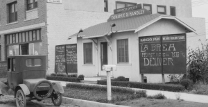 Donahue-Handley Real Estate office, 322 South La Brea Avenue, 1925 (enlargement of previous photograph). The chalkboard signs promise that they can deliver La Brea frontage and lots on Hauser Boulevard for $3000.