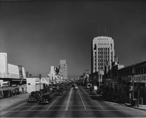 Wilshire Boulevard looking east from Dunsmuir Avenue. The Dominguez Wilshire building on the right; the White Spot, a popular restaurant and cocktail lounge, on the left. (Dick Whittington Photography Collection, 1924-1987; USC Digital Library)