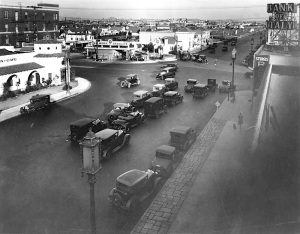Intersection of Wilshire Boulevard and La Brea Avenue, 1928. Looking east along Wilshire. Note the Gilmore gas station on the northeast corner of Wilshire and La Brea; the following year it would be demolished to make way for the E. Clem Wilson Building. The white building at upper left is the Dyas-Carleton Cafe, built in 1925. The Bank of Italy (sign upper right corner) would become the Bank of America. (Los Angele Public Library)