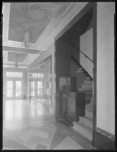 Wilsire Tower entryway and staircase, circa 1930. (Mott-Merge Collection; California State Library)