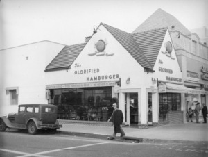 Wimpy Grill (located at 5425 Wilshire Boulevard, later the Flying Saucer restaurant) and the adjacent shops (later Brown's Wilshire Bakery) were remodeled to create one large commercial space to accommodate a Staples office supply store. Photograph circa 1938. (Herman J. Schultheis Collection; Los Angeles Public Library)