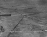 Aerial view of Carthay Center, looking west across field of the first Rogers Airport at Wilshire Boulevard and Fairfax Avenue. Wilshire Boulevard is the tree-lined street seen in the center of the image, 1922. (Los Angeles Public Library.)