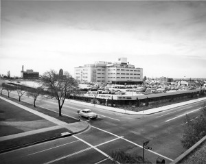 View looking southwest from the intersection of 6th Street and Ogden Drive showing the May Co. and its multi-story parking structure.  (Photo by Julius Shulman via Getty Collection)